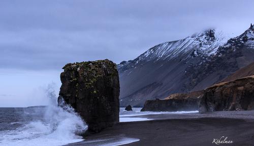 Black Sand Beach in Iceland by Kathy Thalman